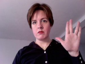 Your blogger is holding up the Vulcan salute.